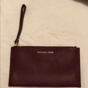 Wine colored Michael Kors Clutch. New with tags